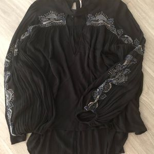 Embellished high low tunic.
